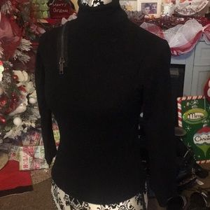 Burberry turtle neck zipper blouse made in Italy.